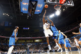 Dallas Mavericks v Oklahoma City Thunder: Serge Ibaka and Brendan Haywood Photographic Print by Layne Murdoch