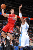 Los Angeles Clippers v Denver Nuggets: Blake Griffin and Nene Photographic Print by Garrett Ellwood