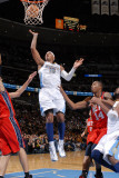 New Jersey Nets v Denver Nuggets: Carmelo Anthony and Derrick Favors Photographic Print by Garrett Ellwood