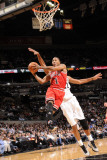 Chicago Bulls v San Antonio Spurs: Derrick Rose and Tim Duncan Photographic Print by D. Clarke Evans