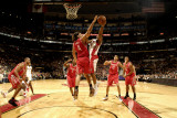 Houston Rockets v Toronto Raptors: Luis Scola and DeMar DeRozan Photographic Print by Ron Turenne
