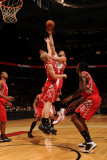Houston Rockets v Toronto Raptors: Linas Kleiza and Chase Budinger Photographic Print by Ron Turenne