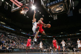 Los Angeles Clippers v Minnesota Timberwolves: Eric Gordon and Luke Ridnour Photographic Print by David Sherman