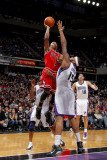 Chicago Bulls v Sacramento Kings: Derrick Rose and DeMarcus Cousins Photographic Print by Rocky Widner