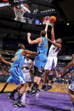 New Orleans Hornets v Sacramento Kings: Carl Landry and Jason Smith Photographic Print by Rocky Widner