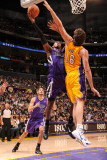 Sacramento Kings v Los Angeles Lakers: Jason Thompson and Pau Gasol Photographic Print by Andrew Bernstein