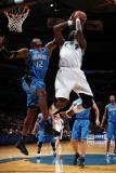 Orlando Magic v Washington Wizards: Andray Blatche and Dwight Howard Photographic Print by Ned Dishman