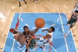 Milwaukee Bucks v Denver Nuggets: Larry Sanders, Carmelo Anthony and Nene Photographic Print by Garrett Ellwood