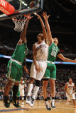 Boston Celtics v Charlotte Bobcats: Glen Davis and Shaun Livingston Photographic Print by Kent Smith