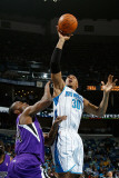 Sacramento Kings v New Orleans Hornets: David West and Carl Landry Photographic Print by Chris Graythen