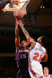 Atlanta Hawks v New York Knicks: Wilson Chandler and Al Horford Photographic Print by Jeyhoun Allebaugh