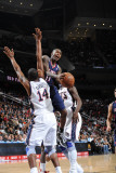Atlanta Hawks v New Jersey Nets: Jamal Crawford and Derrick Favors Photographic Print by Jesse D. Garrabrant