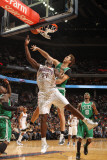 Boston Celtics v Charlotte Bobcats: Semih Erden and Kwame Brown Photographic Print by Kent Smith