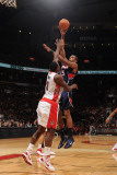 Atlanta Hawks v Toronto Raptors: Al Horford and Joey Dorsey Photographic Print by Ron Turenne