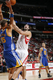 Golden State Warriors v Houston Rockets: Luis Scola and Andris Biedrins Photographic Print by Bill Baptist