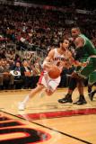Boston Celtics v Toronto Raptors: Jose Calderon and Glen Davis Photographic Print by Ron Turenne