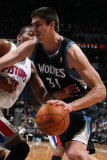 Detroit Pistons v Minnesota Timberwolves: Darko Milicic and Greg Monroe Photographic Print by David Sherman