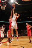Houston Rockets v Toronto Raptors: Andrea Bargnani and Brad Miller Photographic Print by Ron Turenne