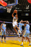 Denver Nuggets v Golden State Warriors: Reggie Williams Photographic Print by Rocky Widner