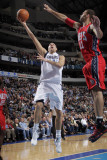 New Jersey Nets v Dallas Mavericks: Dirk Nowitzki and Brook Lopez Photographic Print by Glenn James