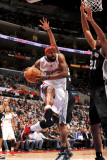San Antonio Spurs v Los Angeles Clippers: Baron Davis and Tim Duncan Photographic Print by Noah Graham