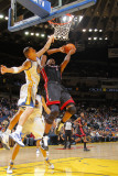 Miami Heat v Golden State Warriors: Chris Bosh and Andris Biedrins Photographic Print by Rocky Widner