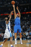 Dallas Mavericks v New Orleans Hornets: Dirk Nowitzki and David West Photographic Print by Layne Murdoch