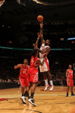 Houston Rockets v Toronto Raptors: Amir Johnson and Jordan Hill Photographic Print by Ron Turenne