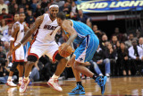 New Orleans Hornets v Miami Heat: Chris Paul and LeBron James Photographic Print by James Riley