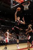 Chicago Bulls v Toronto Raptors: Omer Asik Photographic Print by Ron Turenne