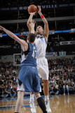 Minnesota Timberwolves v Dallas Mavericks: Dirk Nowitzki and Kevin Love Photographic Print by Glenn James