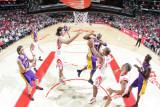 Los Angeles Lakers v Houston Rockets: Kobe Bryant and Chuck Hayes Photographic Print by Bill Baptist