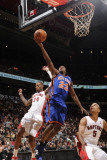 New York Knicks v Toronto Raptors: Wilson Chandler and Jerryd Bayless Photographic Print by Ron Turenne
