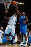 Dallas Mavericks v New Orleans Hornets: Brendan Haywood and Emeka Okafor Photographic Print by Chris Graythen
