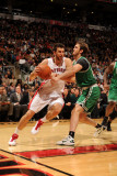 Boston Celtics v Toronto Raptors: Andrea Bargnani and Semih Erden Photographic Print by Ron Turenne