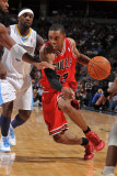 Chicago Bulls v Denver Nuggets: C.J. Watson and Ty Lawson Photographic Print by Garrett Ellwood