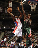 Milwaukee Bucks v Detroit Pistons: Rodney Stuckey and Larry Sanders Photographic Print by Allen Einstein