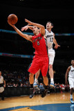 Toronto Raptors v Washington Wizards: Jose Calderon and Kirk Hinrich Photographic Print by Ned Dishman