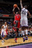 Chicago Bulls v Sacramento Kings: Luol Deng and Donte Greene Photographic Print by Rocky Widner