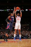 Atlanta Hawks v New York Knicks: Josh Smith and Wilson Chandler Photographic Print by Jeyhoun Allebaugh