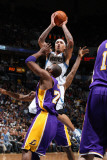 Los Angeles Lakers v Minnesota Timberwolves: Michael Beasley and Kobe Bryant Photographic Print by David Sherman