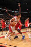 Philadelphia 76ers v Toronto Raptors: Jose Calderon and Jrue Holiday Photographic Print by Ron Turenne