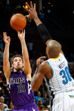 Sacramento Kings v New Orleans Hornets: Beno Udrih and David West Photographic Print by Chris Graythen