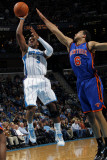 New York Knicks v New Orleans Hornets: Chris Paul and Landry Fields Photographic Print by Layne Murdoch
