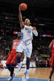 New Jersey Nets v Denver Nuggets: Carmelo Anthony and Johan Petro Photographic Print by Garrett Ellwood