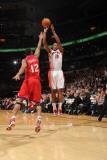 Philadelphia 76ers v Toronto Raptors: DeMar DeRozan and Evan Turner Photographic Print by Ron Turenne