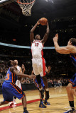 New York Knicks v Toronto Raptors: Ed Davis and Toney Douglas Photographic Print by Ron Turenne