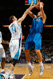 Dallas Mavericks v New Orleans Hornets: Dirk Nowitzki and Jason Smith Photographic Print by Chris Graythen