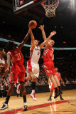 Houston Rockets v Toronto Raptors: Linas Kleiza, Jordan Hill and Chase Budinger Photographic Print by Ron Turenne