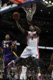 Los Angeles Lakers v Detroit Pistons: Rodney Stuckey and Kobe Bryant Photographic Print by Allen Einstein